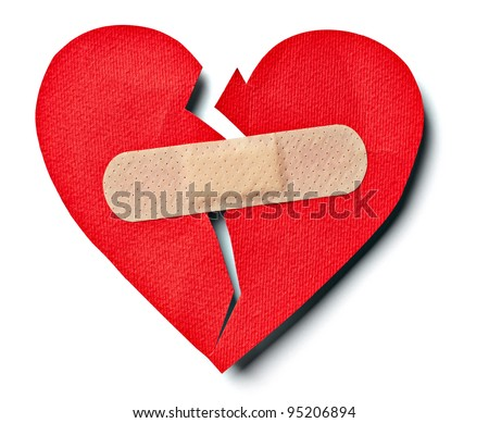 close up of  a plaster and  paper broken heart on white background with clipping path