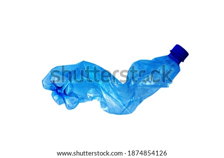 Photo of  Close up of a plastic bottle isolated on white background. Recycling concept. Used plastic bottle crushed and crumpled against on the white background. Ocean pollution, save the earth concept.