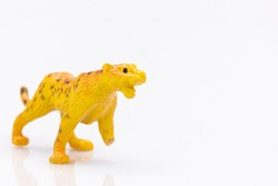 close up of a plastic panther toy isolated on a white background