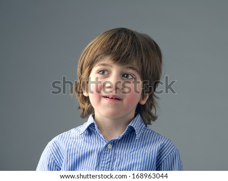 Close-up of a positive beautiful kid isolated #168963044