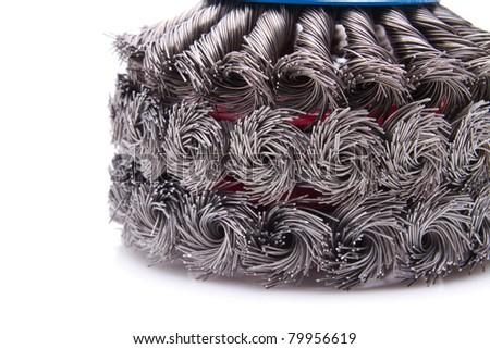 close up of a power rotating metal brush