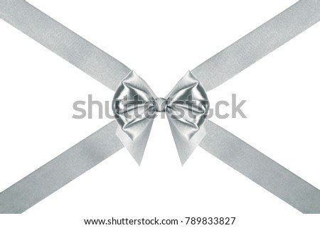 close up of a present silver silk ribbon bow with crosswise ribbons on white background #789833827