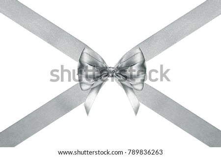 close up of a present silver silk ribbon bow with crosswise ribbons on white background #789836263