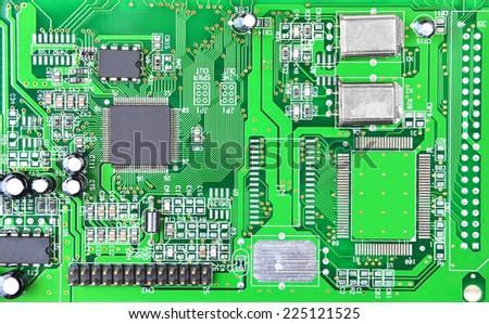 Close up of a printed green computer circuit board
