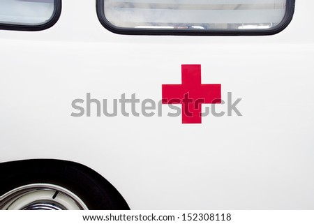 Close up of a red cross on a vintage ambulance