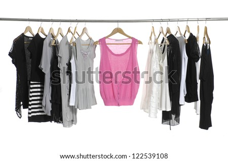 close up of a red dress fashion female clothing hanging on hangers