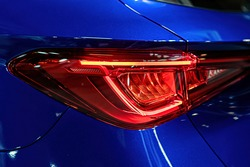 close-up of a red led taillight on a modern car, detail on the rear light of a car