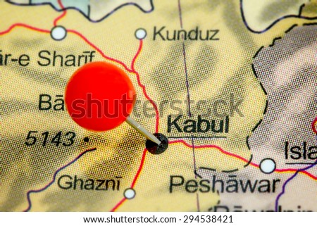 Close-up of a red pushpin on a map of Kabul, Afghanistan
