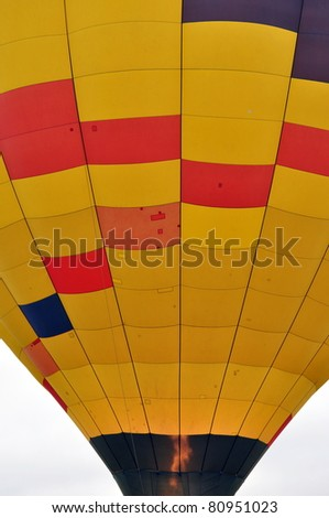 Close up of a red, yellow, orange and blue hot air balloon.
