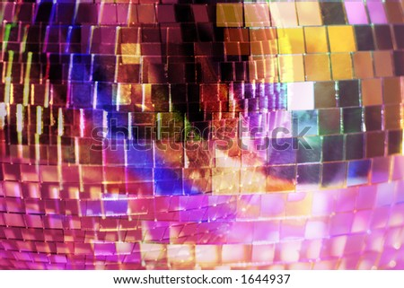 close-up of a reflective mirrorball with differnet colours shining