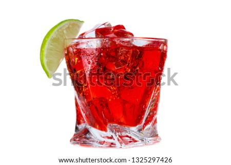 close up of a refreshing classic cocktail with vodka and cranberry juice served on the rocks with a lime wedge garnish isolated on a white background