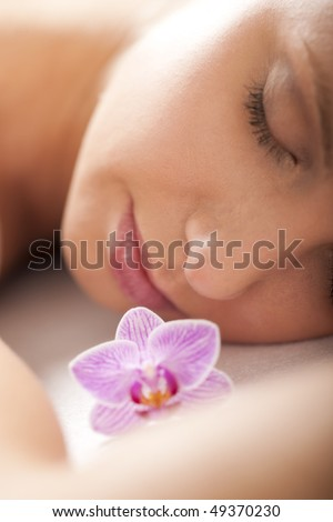 Close-up of a relaxed woman receiving spa treatment, selective focus - stock photo