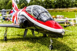 close up of a remote controlled jet fighter on the grass