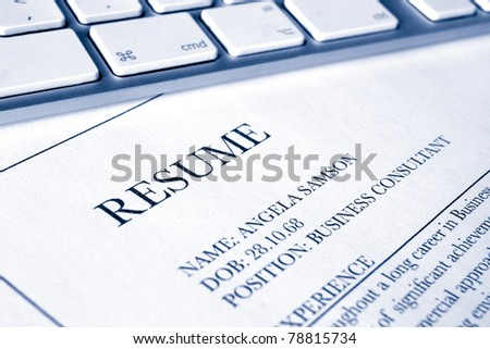 close up of a resumé or cv document with blue duotone effect
