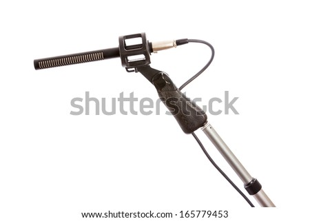 Close-up of a rifle microphone on a boom pole against a white background