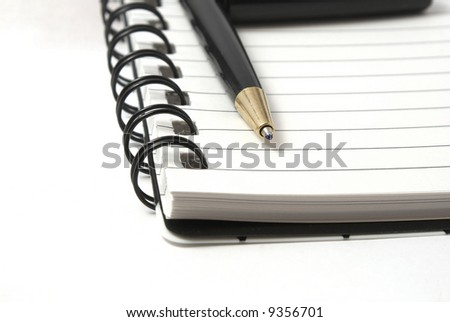 Close up of a ring tablet with a ballpoint pen.