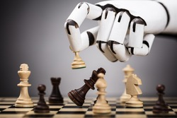Close-up Of A Robot's Hand Playing Chess