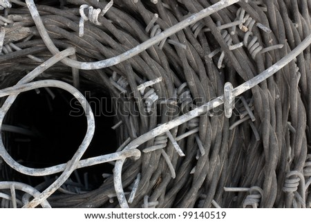 close up of a roll of barb wire background