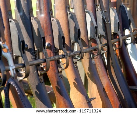 close up of a row with rifles