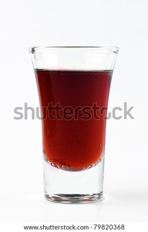 Close up of a rum cocktail shot isolated on white background