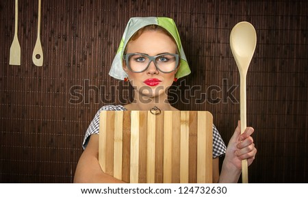Close Up Of A Rural Funny Woman Cook With Kitchen Cutting