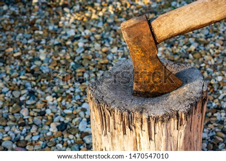Close up of a rusty axe in a wooden chopping block Stock fotó ©