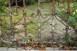 Close up of a rusty decorative heart shaped floral ornament of a metal fence, entrance gate. Poland, europe