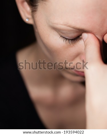 Close up of a sad and depressed young woman.