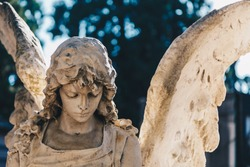 Close up of a sculpture stone carved in the old Monumentale Cemetery in Milan