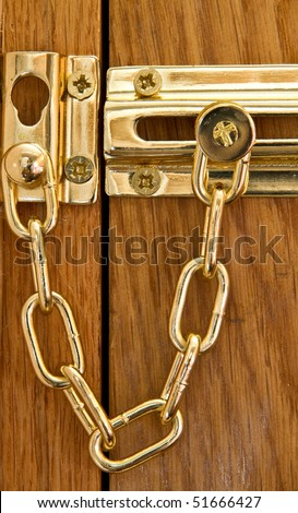 Close up of a security door chain