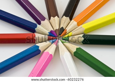 Close-up of a selection of colored pencil crayons, arranged like a color wheel