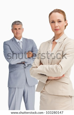 Close-up of a serious business people with folded arms against white background