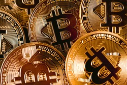 Close Up Of A Set Of Golden Bitcoins Stacked Together With Visible Logo. Cryptocurrencies Growth Concept. Bitcoin Dominance Concept. Mining or blockchain technology.