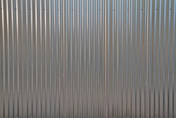 Close up of a shiny corregated steel wall