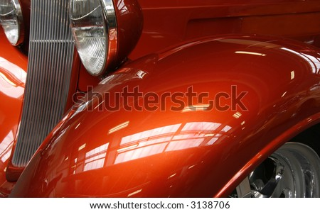 Close-up of a shiny orange hot rod