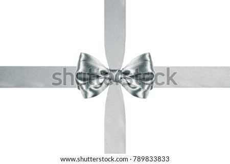 close up of a shiny silver satin ribbon bow with crosswise ribbons on white background #789833833
