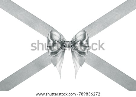 close up of a shiny silver silk ribbon bow with crosswise ribbons on white background #789836272