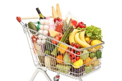 Close up of a shopping cart with food isolated on white background
