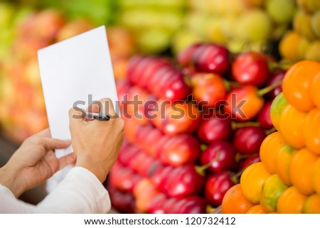 Close up of a shopping list at the grocery store