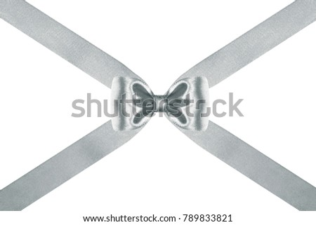 close up of a  silver silk ribbon bow with crosswise ribbons on white background #789833821