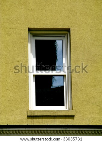 close up of a single window on a old run down house