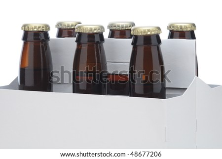 Close up of a Six pack of Brown beer bottles in blank carrier isolated over a white background