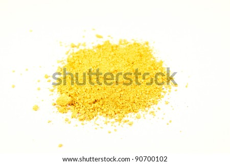 close up of a small portion of bright ocher pigment isolated over white