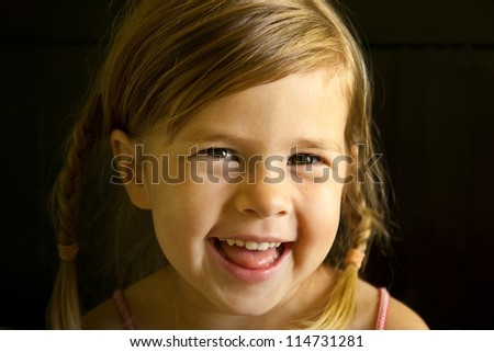 Close up of a smiling girl with braided hair #114731281