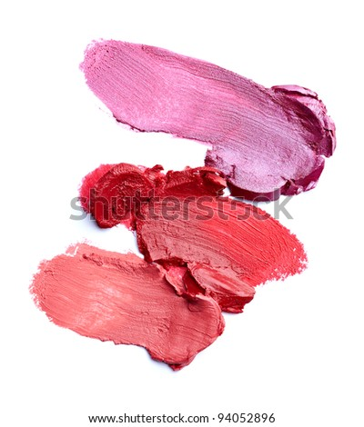 close up of  a smudged lipstick on white background