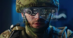 Close-up of a soldier using high-tech sunglasses with holographic display