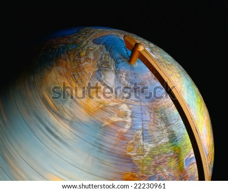 Close up of a spinning globe on black