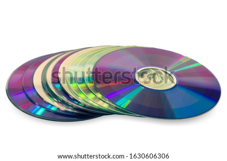 Close up of a stack compact discs (CD/DVD). Isolated on white background