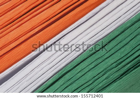 Close-up of a stack of colorful papers representing Indian flag colors