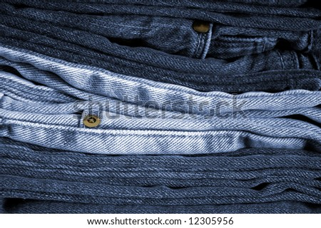 Close-up of a stack of folded blue jeans